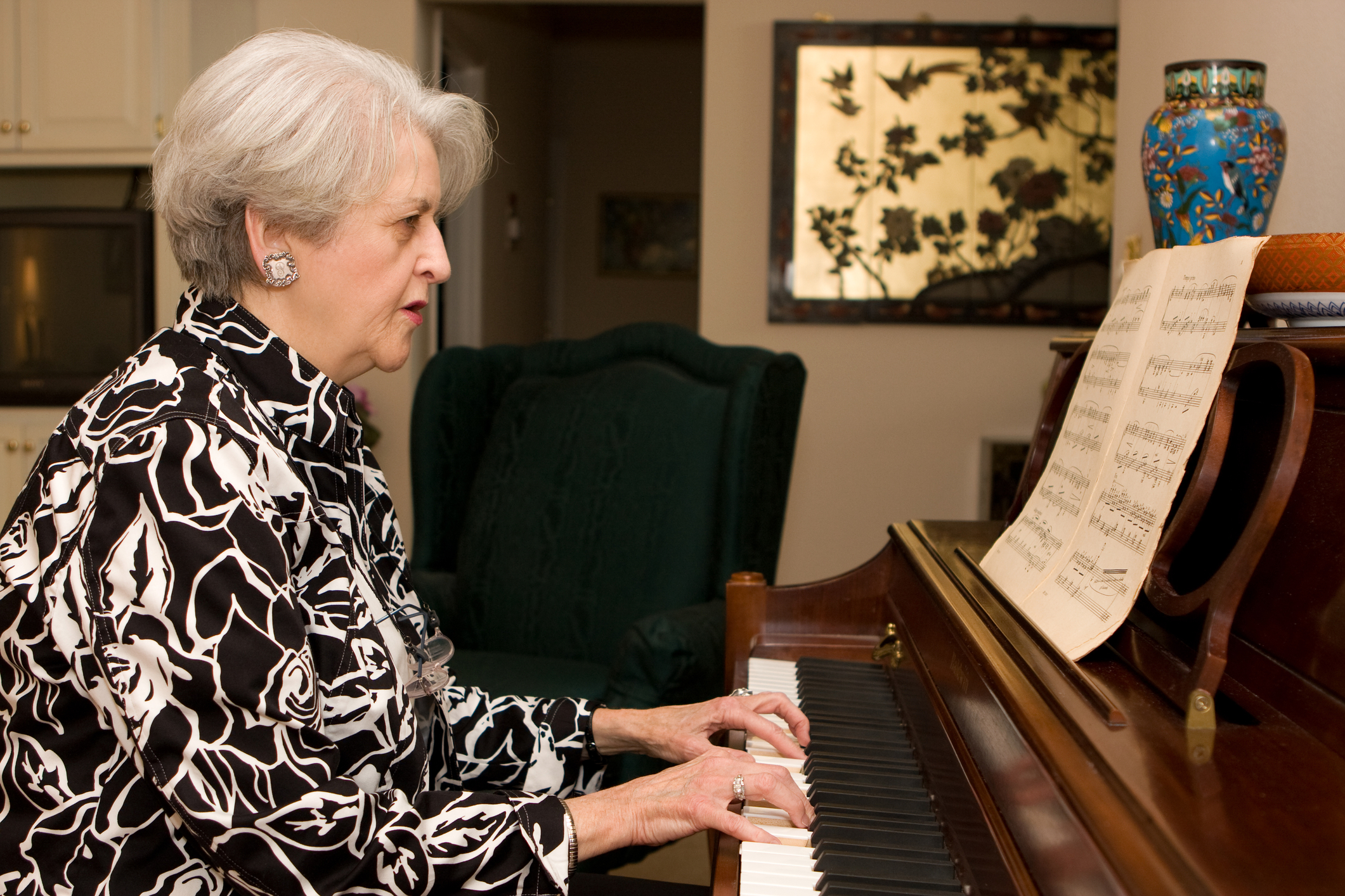 http://www.dreamstime.com/stock-photos-senior-woman-playing-piano-image11729183